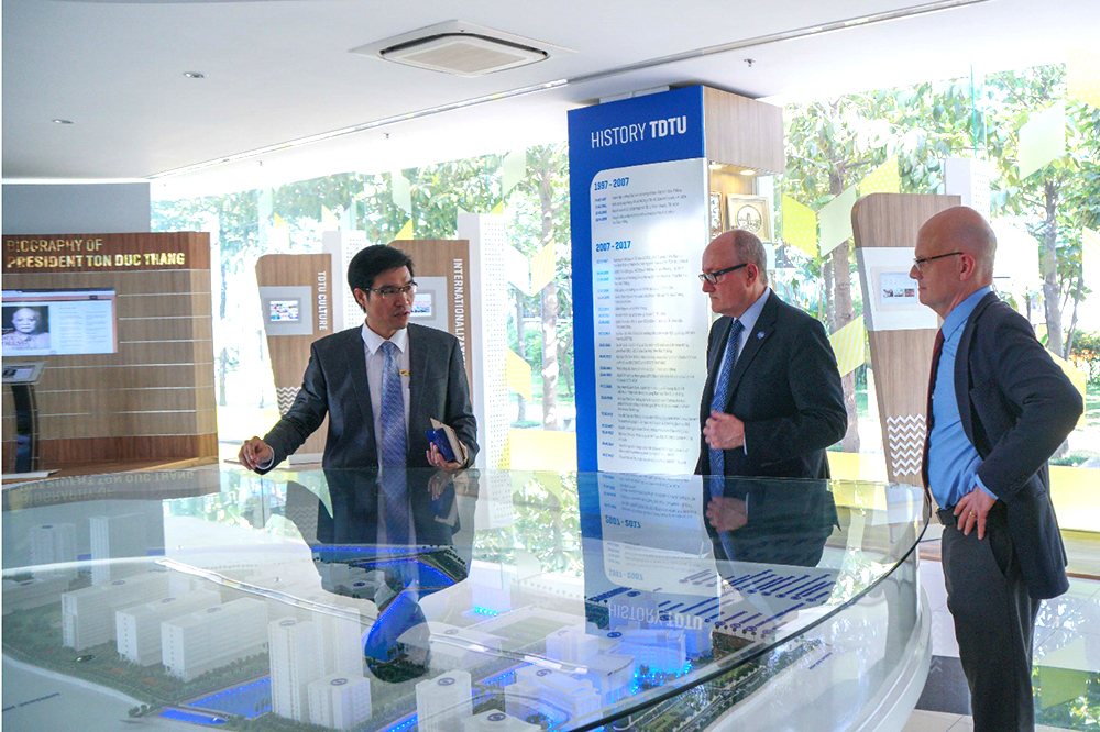 Dr. Tran Trong Dao, Vice President of TDTU shows GSU delegation around TDTU after the meeting